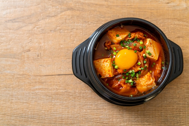 'kimchi jjigae' or kimchi soup with tofu and egg or korean kimchi stew