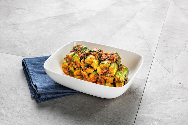 Kimchi (korean fermented food) on gray background