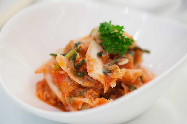 Kimchi (korean food) close up on white background