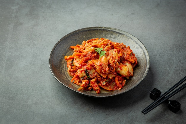 Kimchi ready to eat in black plate