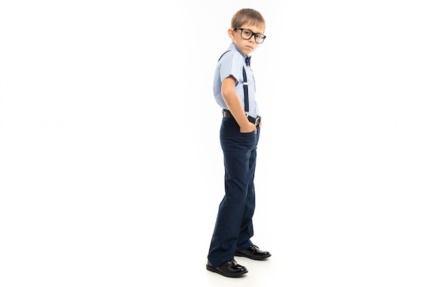 Kind young caucasian teenager stands on white background