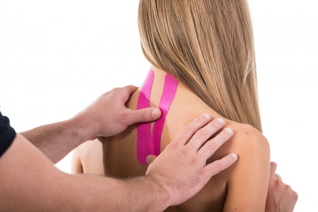 Kinesio tapes on the neck of a woman