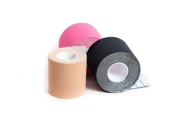 Kinesiological multi-colored tapes for fixing muscles during sports and after injuries on a white surface. kinesiological taping of athletes.