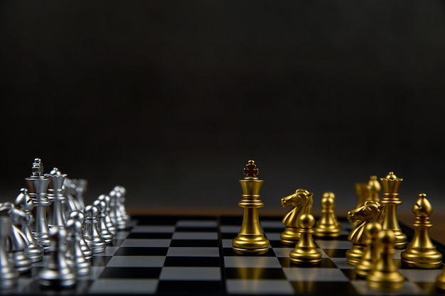 A king chess in front of the line. concept of leadership and business strategic plan.