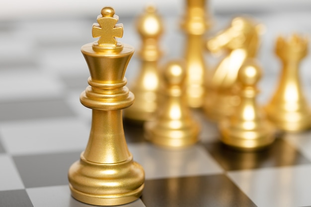 King of chess pieces on a chessboard. concept for strategy, business victory.