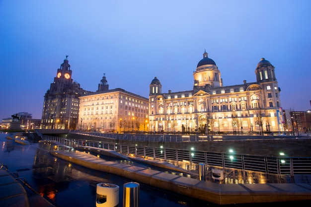 The king edward vii monument and the liver building, liverpool, england