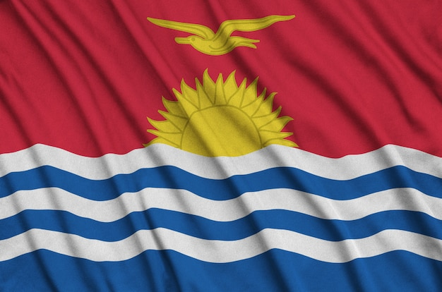 Kiribati flag is depicted on a sports cloth fabric with many folds.