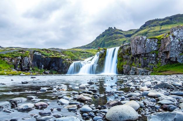 Kirkjufellsfoss, a summer morning down the waterfalls. iceland