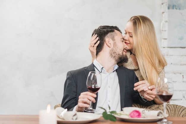 Kissing close couple with wine