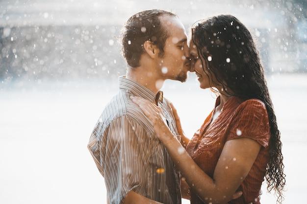 Kissing couple under summer rain