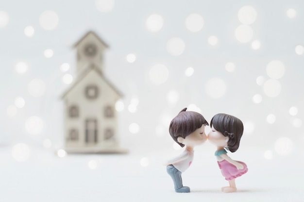 Kissing couple with home background for valentine's day or wedding concept