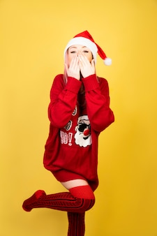 Kissing girl with red santa suit