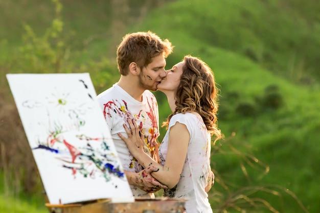 Kissing behind the sketchbook