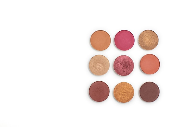 Kit of colorful eyeshadow refill over a white background