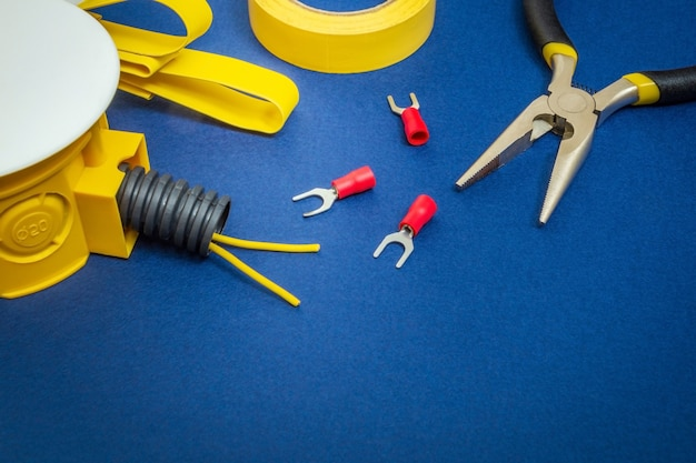 Kit spare parts and tool, wires for electrical prepared before repair or setting on blue workshop table