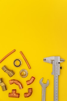 Kit tools for plumbing isolated on yellow background