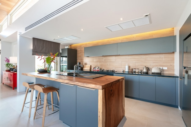 Kitchen area which feature island counter and built in furniture