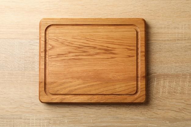 Kitchen board on wooden background