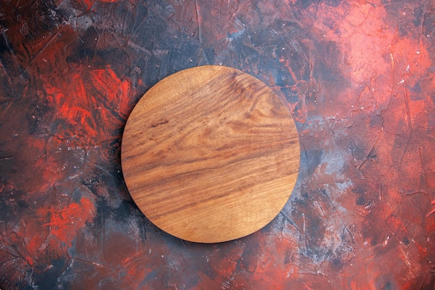 Kitchen board wooden kitchen board on the red-blue table