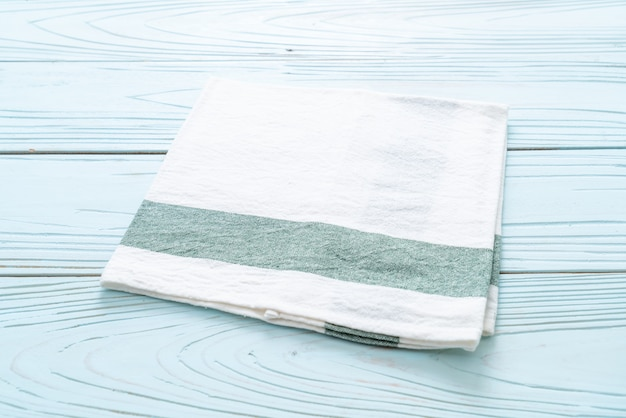 Kitchen cloth (napkin) on blue wooden background