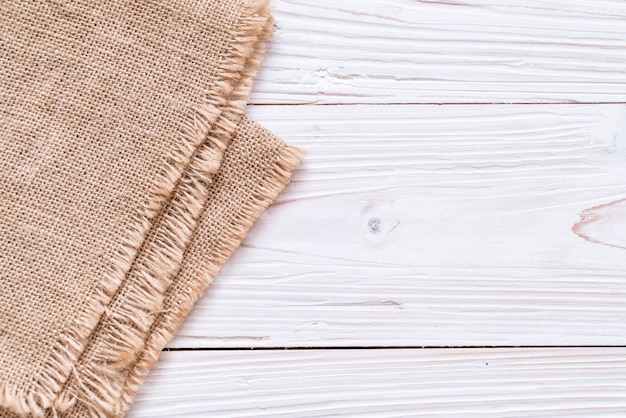 Kitchen cloth (napkin) on wood background