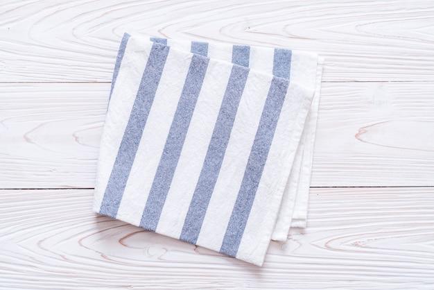 Kitchen cloth (napkin) on wood table
