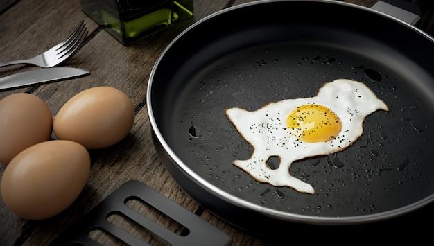 Kitchen composition, chick-shaped egg on skillet