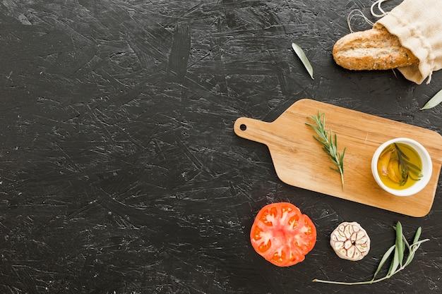 Kitchen desk with oil bread and tomato
