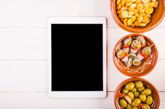 Kitchen desktop with tablet and snack plates