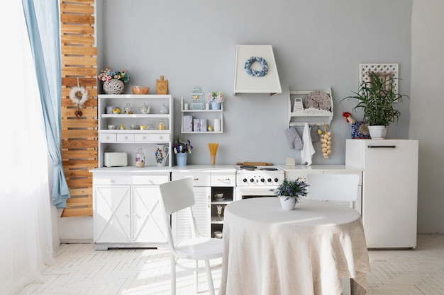 Kitchen and dining room with white furniture