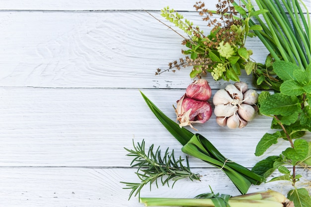 Kitchen herb garden concept - natural fresh herbs and spice on rustic wood background in the kitchen for ingredient food