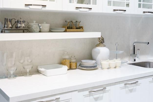 Kitchen interior with kitchenware including porcelain kitchenware, crockery, plates
