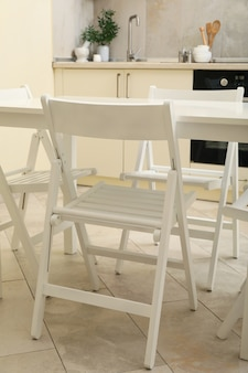 Kitchen interior with wooden table and folding chairs