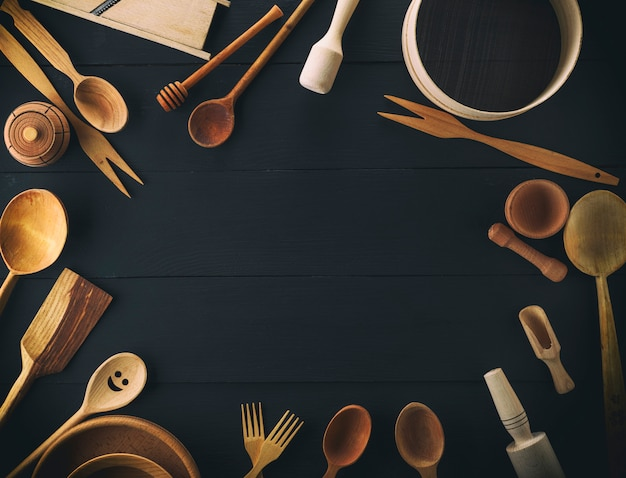 Kitchen items on a black table, top view