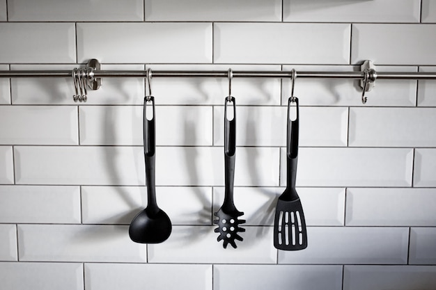 Kitchen items hanging on the wall in the kitchen