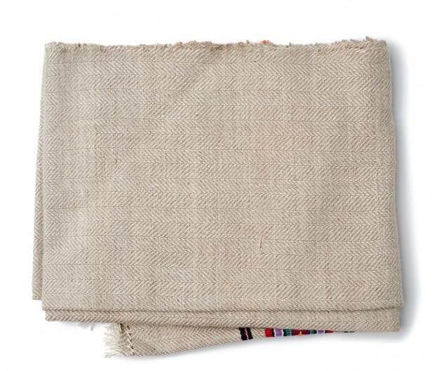 Полотенце кухонное постельное серое на белом фоне, вид сверху