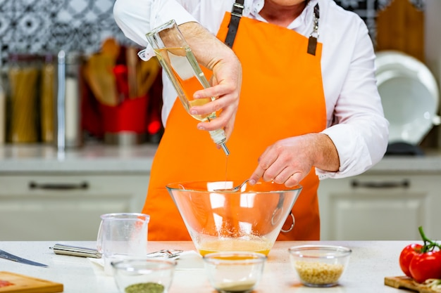 Kitchen preparation: the chef mixes the ingredients in the bowl