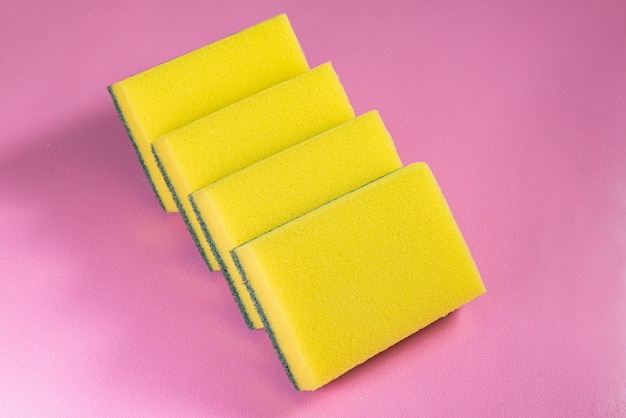 Kitchen sponge on the pink background