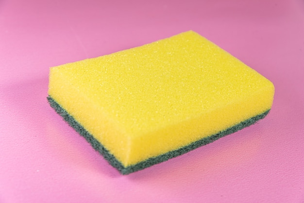 Kitchen sponge on the pink surface