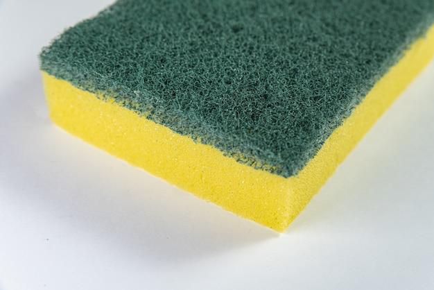 Kitchen sponge on the white table