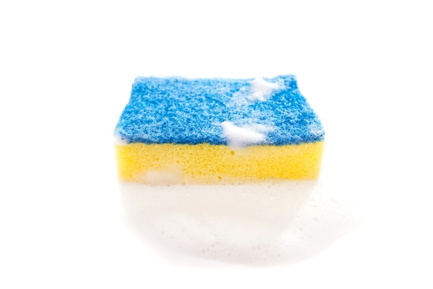 Kitchen sponge with foam isolated on white background.