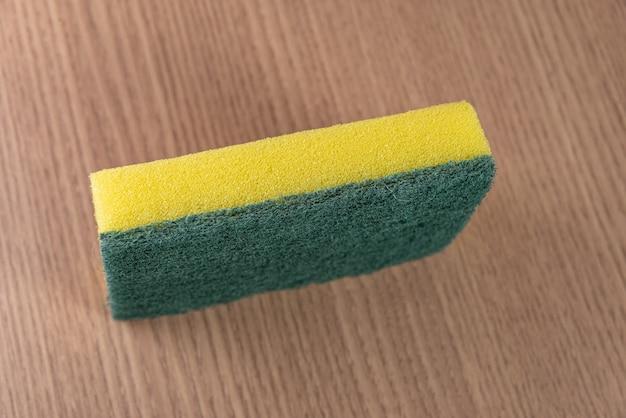 Kitchen sponge on the wooden background