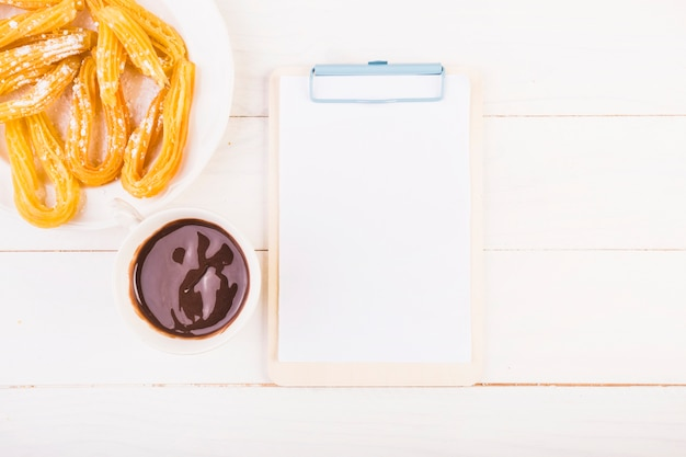Kitchen table with clipboard and plate with pretzels