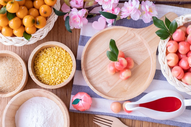 Kitchen table with deletable imitation fruits, fruit shaped mung beans