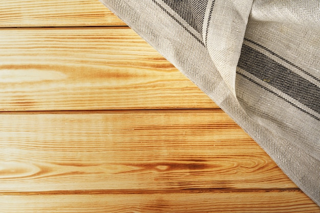 Kitchen towel or napkin over the wooden table. close up.