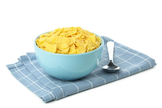 콘플레이크와 포크 흰색 배경에 고립의 그릇으로 주방 수건