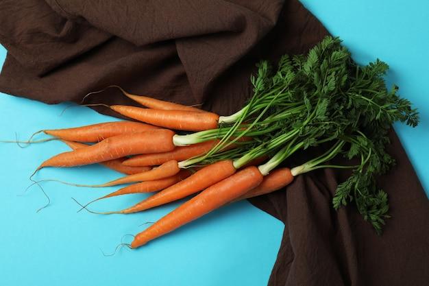 Кухонное полотенце с морковью на синем фоне