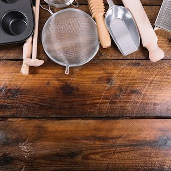 Kitchen utensil for baking cake on wooden table