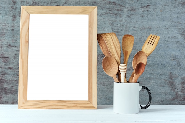 Kitchen utensils background with a white blank, copy space