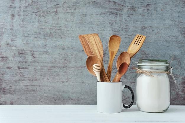 Kitchen utensils in ceramic cup, copy space